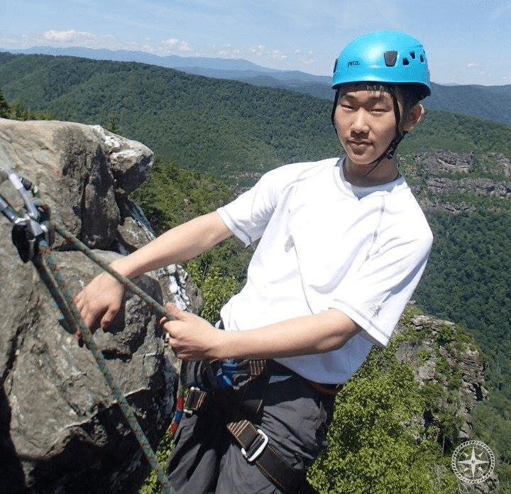 Ian Rock Climbing with NCOBS